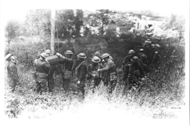 Soldiers establish telephone communication between division and Corps Headquarters, 322nd Field Signal Battalion, 1st Army Corps attached to 35th Division, Sept. 29, 1918.