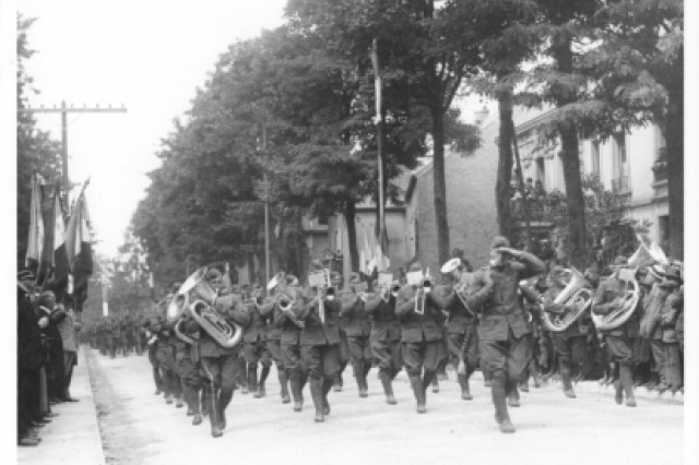 A World War I era marching band participates in a parade.