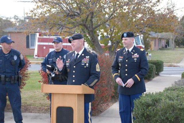 Fort A.P. Hill's Officers Dustin E. Clymore and Carl F. Ballagh prepare to raise the POW-MIA flag while Command Sergeant Major Keith R. Whitcomb addresses soldiers and their families, DA civilians, and guests about America's Missing in Action. Commander Peter E. Dargle presides.