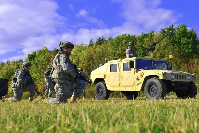Troops with 2nd Cavalry Regiment hold a security position during Operation Saber Junction, Oct. 17, 2012, near Fuchsstein, Germany. The regiment engaged in a Decisive Action Training Environment rotation with multinational forces to train interoperability for future contingency operations.