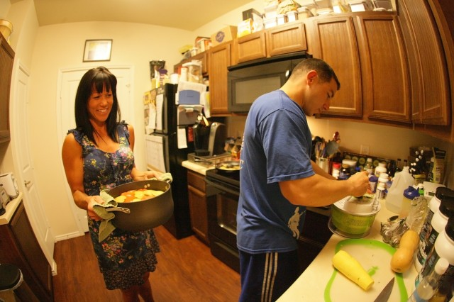 Jeannie and 1st Lt. Blake Marshall, A Battery, 2nd Battalion, 2nd Field Artillery, cook a nutritionally balanced dinner Nov. 2 at their home in Lawton.