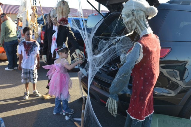 Costumed 31st Air Defense Artillery Brigade Soldiers get into the spirit of Halloween at the brigade's trunk or treat single Soldier and family fun day. Brigade members and their families held three activities to build camaraderie throughout the unit and to give Soldiers' children a safe alternative to Halloween trick or treating.