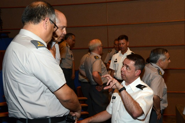 Col. (Dr.) James Sheehan (right), U.S. Army South deputy chief of staff of medical, speaks to speaks to two Chilean officers immediately following his medical presentation to more than 200 military medical students and doctors at the Hospital Militar de Santiago, Nov. 6, 2012, in Santiago, Chile. Sheehan was part of an Army South delegation of staff officers participating in the annual army-to-army staff talks between the U.S. and Chilean armies Nov. 5, in Santiago. The staff talks are scheduled to end Nov. 7, and will serve as a bilateral forum for strategic-level discussion between respective armies.