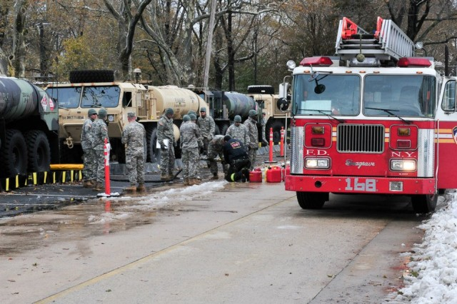 A fire truck from the New York City Fire Department is fueled by Soldiers with 710th Brigade Support Battalion, 3rd Brigade Combat Team, 10th Mountain Division, who deployed on rapid notice to support the Hurricane Sandy relief efforts in the city.