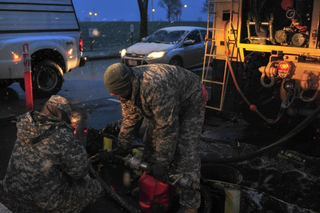 Soldiers in 710th Brigade Support Battalion, 3rd Brigade Combat Team, 10th Mountain Division, provide gas for vehicles in response to Hurricane Sandy, Nov. 7, 2012. They are currently operating out of Fort Hamilton, N.Y.