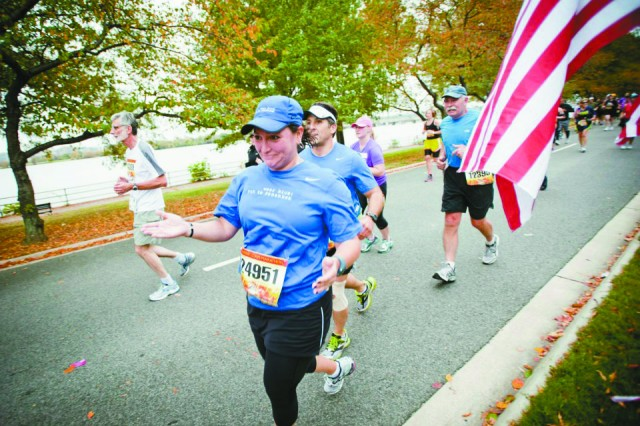 Rachel Elizalde-Powell reacts as she approaches the wear blue mile portion of the annual Marine Corps Marathon in Washington D.C. Oct. 28.
