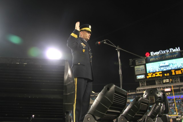 Brig. Gen. David MacEwen takes center stage at Ever Bank Field in Jacksonville, FL, to swear-in 173 new service members during the Jacksonville Jaguars Military Appreciation game.