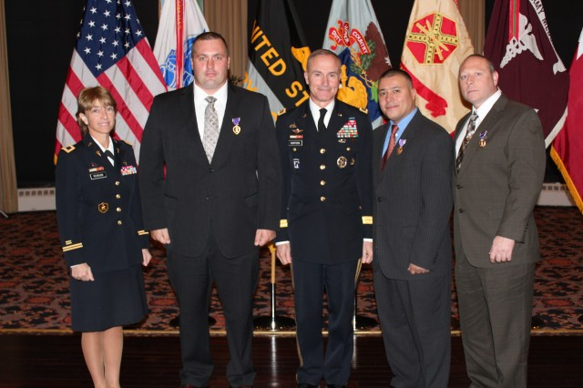 (Left to right) Col. Felicia Pehrson, West Point Health Service Area commander, Sgt. Sean Hook, Lt. Gen. David H. Huntoon Jr., United States Military Academy superintendent, Spc. Miguel Ramos and Sgt. Ralph Cipriati pose for a photo during a Warrior Care Month banquet and Purple Heart presentation, hosted by the Soldier and Family Assistance Center, at the West Point Club, Nov. 8, 2012.  These three former Soldiers were assigned to the Keller Army Community Hospital Warrior Transition Unit.