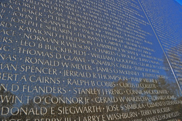 Names of just some of the 58,282 Soldiers, Sailors, Marines, Airmen lost in Vietnam are etched into the black, polished granite of The Wall that pays homage to them. Nov. 13, 2012, marks the 30th anniversary of the dedication of the Vietnam Veterans Memorial.