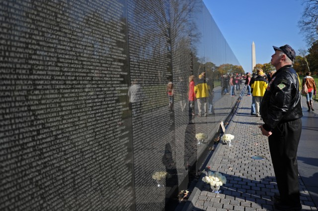 A Vietnam veteran looks over the some of the 58,282 names inscribed in the black, polished granite of the Vietnam Veterans Memorial. Nov. 13, 2012, marks the 30th anniversary of the dedication of the memorial.