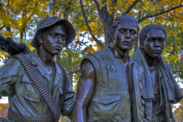 """The Three Soldiers"" bronze rests near the entrance of the path leading leading to the Vietnam Veterans Memorial. Nov. 13, 2012, marks the 30th anniversary of the dedication of The Wall which displays the etched names of 58,282 service members who lost their lives in Southeast Asia."