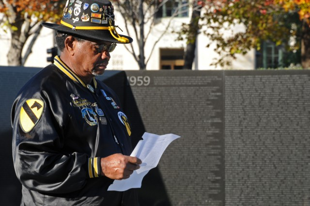 Edward Times looks over the 30 names he will read of the 58,282 service members who lost their lives in the Vietnam War. Times served with the 1st Battalion, 7th Cavalry, at the Battle of Ia Drang Valley in 1965. Nov. 13, 2012, marks the 30th anniversary of the dedication of the Vietnam Veterans Memorial.