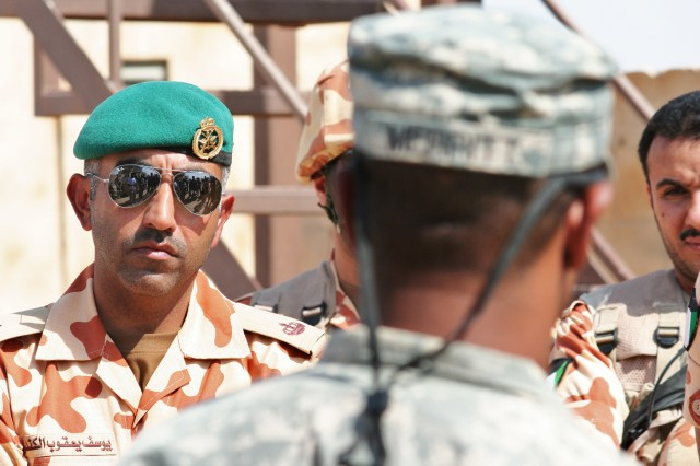 Maj. Josef, Kuwaiti 25th Commando Brigade (left), listens as 1st Lt. Maurice Merritt reviews a urban-operations training exercise involving Soldiers of the 4th Battalion, 118th Infantry Regiment, South Carolina Army National Guard and the Kuwaiti 25th Commando Brigade at Camp Buehring, Kuwait on Oct. 16. In addition to taking over security-force operations in northern Kuwait in April, the 4th Battalion also assumed a training partnership with the Kuwaiti Military -- one of the region's best led, trained, and equipped military organizations. Merritt, who was the 4th Battalion's officer-in-charge of the exercise, is from Wichita, Kansas. (U.S. Army Photo by Spc. Kate McGrath, 4th Battalion)