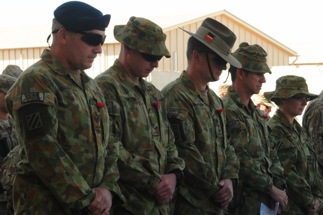 Australian service members pay their respects during a Veterans Day ceremony held at Regional Command (South) Headquarters' Marne Garden (Forward) on Kandahar Airfield, Afghanistan, Nov. 11, 2012. Service members and civilians gathered for the Veterans Day ceremony to honor veterans of the past, present and future.