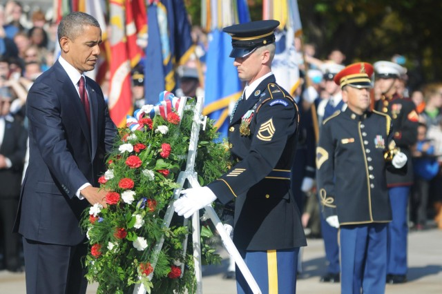 President of the United States, Barack Obama, and Sgt. 1st Class Chad Stackpole, Sergeant of the Guard of the Tomb of the Unknown Soldier, 3d U.S. Infantry Regiment (The Old Guard), lay a wreath in honor of Veterans Day, Nov. 11, at the Tomb of the Unknown Soldier in Arlington National Cemetery, Va. (U.S. Army photo by Staff Sgt. Megan Garcia)