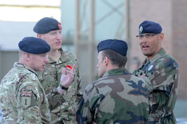 French Army Lt. Col. Olivier Mouton (right), the Regional Command - East French senior liaison officer for Task Force La Fayette, at Bagram Airfield, Afghanistan, attends the Remembrance Day ceremony with other International Security Assistance Forces Soldiers, Nov. 11, 2012.
