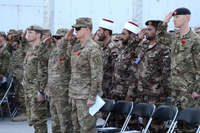 British Army Brig. Felix Gedney, Command Sgt. Maj. Charles Sasser, Brig. Gen. Paul Funk and other International Security Assistance Force Soldiers attend a ceremony in honor of Remembrance Day, at Bagram Airfield, Afghanistan, Nov. 11, 2012.