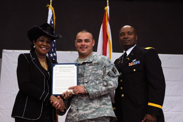 MIAMI, Fla.-Sgt. 1st Class Hector Valleacosta of 841st Eng. Bn., 926th Eng. Bde., 412th Theater Engineer Command, a veteran of Operation Enduring Freedom, was presented a copy of the Congressional Record by U.S. Rep. Felicia Wilson for his service and sacrifice in a Veterans Day ceremony held here at the American Legion Post 29 Nov. 9.