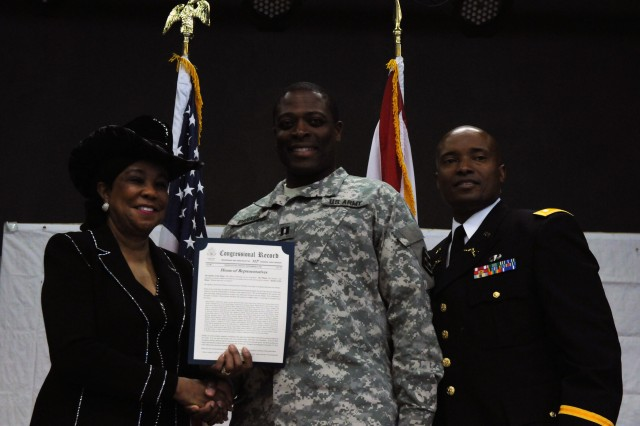 MIAMI, Fla.-Capt. John Parker, a chaplain with 841st Eng. Bn., 926th Eng. Bde., 412th Theater Engineer Command, received a copy of the Congressional Record for his service and sacrifice from U.S. Representative Frederica Wilson in a Veterans Day ceremony held here at the American Legion Post 29 Nov. 9.