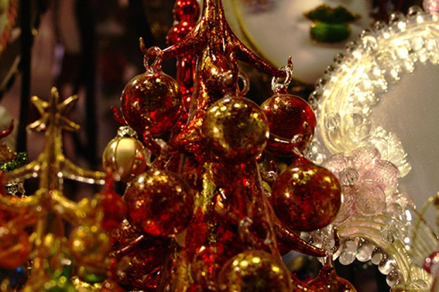 Venetian ornaments and holiday decorations, like the rest of the city, lack little luster. Here, a Murano glass Christmas tree is just one of the many market vendors' offerings on the Campo San Stefano.