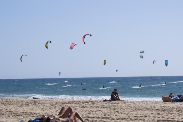 Kite surfers and beach dwellers soak up the sun in Descida da Fonte de Telha, 30 kilometers south of Lisbon.