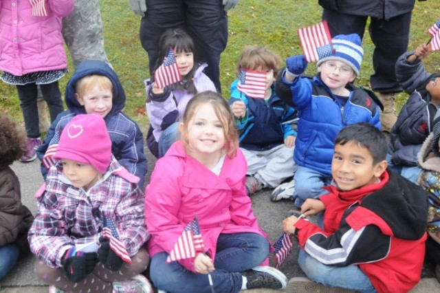 Children wave flags in appreciation of the Veterans Day parade held at Hohenfels, Nov. 8.