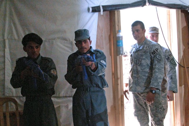 Commanders logging onto the Enterprise Management Decision Support system can query the readiness levels of particular units within the Army Force Generation cycle and make important decisions, such as which units returning from Afghanistan will need the most resources for resetting. Shown here, Afghan National Police officers practice clearing a room while Soldiers observe at Forward Operating Base Kalagush in the Nuristan province of Afghanistan.