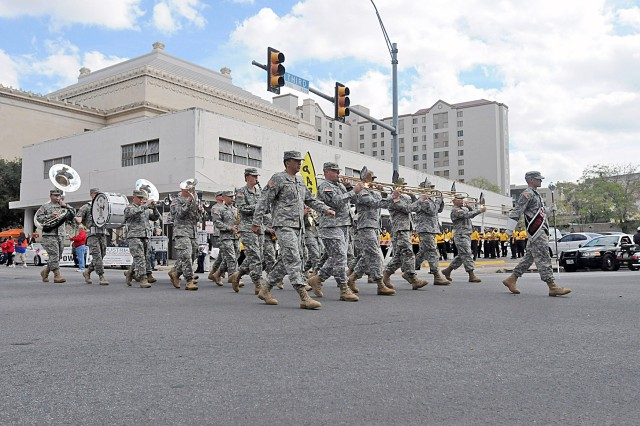 SAN ANTONIO - U.S. Army North's 323rd Army Band marches in time across Third Street Nov. 10 during the Fort Sam Houston and San Antonio Veterans' Day Parade and Wreath Laying Ceremony. Both communities showed their pride in their Veterans in honor of Veteran's Day with profound words, drill displays and a parade that stretched across the downtown area. (U.S. Army photo by Sgt. 1st Class Christopher DeHart, Army North PAO)