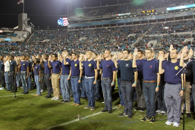 The Army's newest Soldiers take the Oath of Enlistment on EverBank Field in Jacksonville, Fla., during halftime at the Colts vs. Jaguar football game Nov. 8.