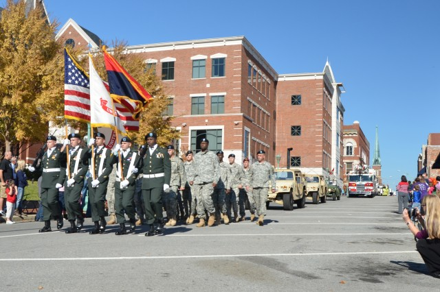 The color guard assigned to 101st Airborne Division, Fort Campbell, Ky., leads their division's formation during the Veterans Day Parade, here, Nov. 10. The parade was held in downtown Clarksville, Tenn., to support the past and the present brave men and women who answered the Nation's call. (U.S. Army photo by Sgt. Shanika L. Futrell, 159th Combat Aviation Brigade Public Affairs/RELEASED)