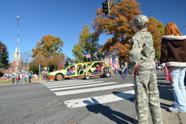 A little boy points at men driving doorless vehicles during the Veterans Day Parade, in Clarksville, Tenn., Nov. 10. The parade was held  to support the past and the present brave men and women who answered the Nation's call. (U.S. Army photo by Sgt. Shanika L. Futrell, 159th Combat Aviation Brigade Public Affairs/RELEASED)