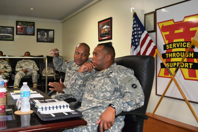 Command Sgt. Maj. Shelton Williamson, command sergeant major, 10th Regional Support Group, talks about the 10th RSG's mission during a brief to Command Sgt. Maj. Steven L. Payton, command sergeant major, United States Army Japan and I Corps (Forward).