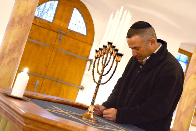 Chaplain Rabbi (Capt.) Andrew Shulman reads a prayer during a memorial service at the historic synagogue in Floss, Germany, honoring those who were displaced during Kristallnacht.