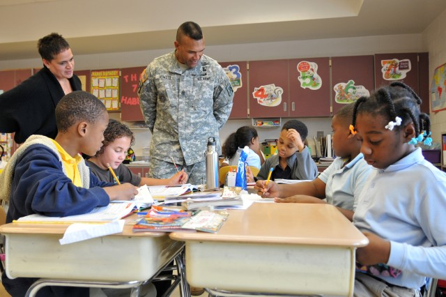 Command Sgt. Maj. Isaia T. Vimoto, XVIII Airborne Corps command sergeant major, speaks with fourth grade students while receiving lunch at the William T. Brown Elementary School of Leadership Nov. 13. (U.S. Army photo by Spc. Paul A. Holston/XVIII Abn. Corps PAO)