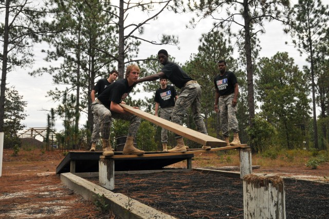 Players from Duke Blue Devils men's basketball team attempt to complete an obstacle course at the Leader's Reaction Course on Fort Bragg Oct. 15. (U.S. Army photo by Spc. Paul A. Holston/XVIII Abn. Corps PAO)