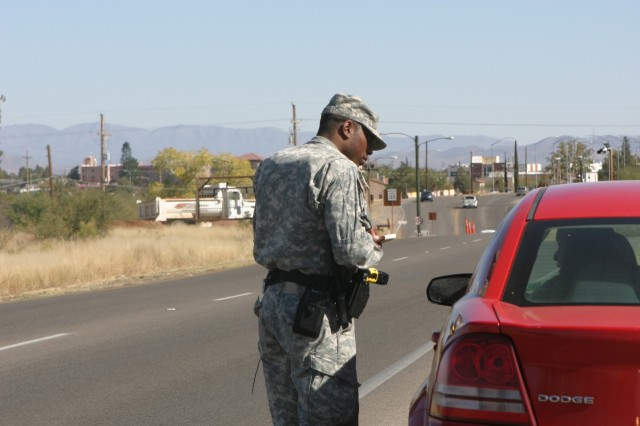 Spc. Daniel Willis, 18th MP Detachment, stops a vehicle for speeding during a routine traffic stop on Fort Huachuca.