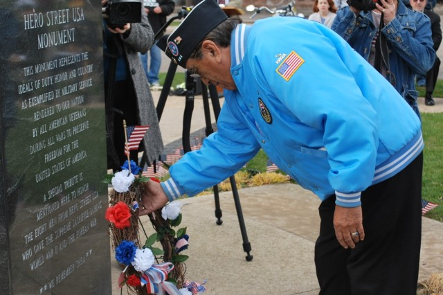 Tony Soliz, president of the Hero Street Monument Committee, places a wreath to honor the eight local servicemen killed in World War II and the Korean conflict during the Hero Street USA Veterans Day event in Silvis, Ill., Nov. 11. The event honored all veterans and included remarks from Silvis Mayor William Fox, Illinois State Sen. Mike Jacobs, Col. Victor Harmon, commander, Army Sustainment Command Distribution Management Center, and Master Chief Petty Officer Miguel Rodriguez, Navy Training Center, Great Lakes, Ill. (Photo by Capt. Johnathon Knapton, ASC Public Affairs)