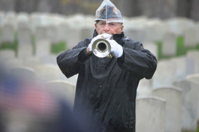 John Adams, Davenport American Legion Post 26, plays Taps at the Rock Island National Cemetery Veterans Day ceremony, Nov. 11.  About 100 people braved the rain, wind and cold to pay respect to our nation's veterans. (Photo by Dan Carlson, ASC Public Affairs)