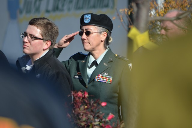 Col. Robin C. Moralez, chief of the Army Sustainment Command's Command Operations and Information Center, salutes during the playing of Taps at the East Moline, Ill., Veterans Day ceremony at the 9th Street Commons Park Nov. 12. (Photo by Dan Carlson, ASC Public Affairs)