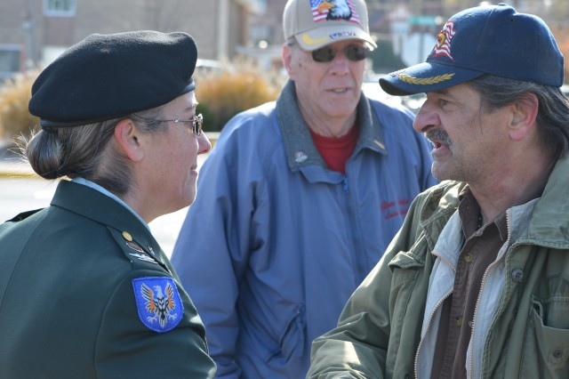 Col. Robin C. Moralez, chief of the U.S. Army Sustainment Command's Command Operations and Information Center, speaks with a veteran following the East Moline, Ill., Veterans Day ceremony at the 9th Street Commons Park Nov. 12. (Photo by Dan Carlson, ASC Public Affairs)