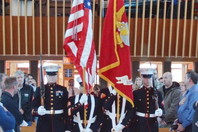 A Marine Corps Honor Guard presents the colors at Trinity Lutheran School Veterans Day commemoration in Davenport, Iowa, Nov. 12. (Photo by Bonnie Seals, ASC Public Affairs)