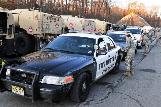 Soldiers from the 10th Mountain Division (LI), run a fuel point in West Orange, N.J., to refuel emergency vehicles that are providing Hurricane Sandy relief.