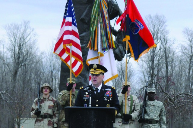 Maj. Gen. Mark A. Milley, Fort Drum and 10th Mountain Division (LI) commander, speaks to community members Friday during the annual Veterans Day observance at Memorial Park.
