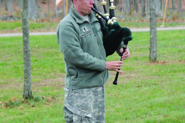 "First Lt. Andrew McGlinchey, 2nd Battalion, 15th Field Artillery Regiment, performs ""Amazing Grace"" on the bagpipes."
