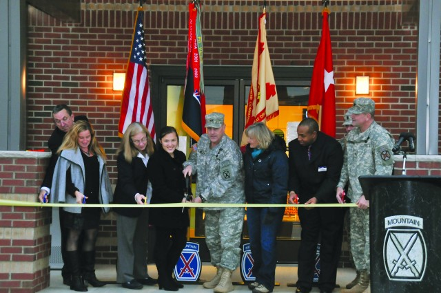 Maj. Gen. Mark A. Milley, center, Fort Drum and 10th Mountain Division (LI) commander, and 17-year-old Elizabeth Kolodgy look up for a photo Friday while leading a ribbon-cutting to officially open the post's new Youth Center. From left, other participants were Michael H. McKinnon, deputy to the garrison commander; Becky Morgia, Child, Youth and School Services program operations specialist; Karin S. Sikirica, CYSS coordinator; Milley's wife, Hollyanne; Steve Ferguson, Youth Center director; and Col. Gary A. Rosenberg, Fort Drum garrison commander.