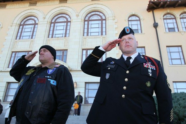 Veteran William Clark and Sgt. 1st Class Eric Cunningham, 1st Battalion, 78th Field Artillery, salute the colors during the Nov. 12 at Fort Sill Veterans Day ceremony outside McNair Hall. Hundreds of service members, veterans, civilians and family members, endured cold temperatures to thank the men and women who answered the call to arms and their families at the 9 a.m. ceremony.