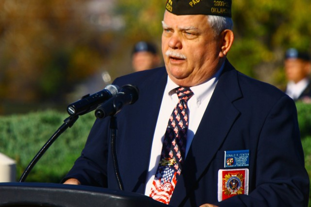 Retired Command Sgt. Maj. Donald Fenter, Lawton Chapter of the Veterans of Foreign Wars Post 5263 commander, speaks at the Fort Sill Veterans Day ceremony Nov. 12 in front of McNair Hall. After serving 26 years in the Army, he worked 14 years in civil service, retiring as the Army Community Service director here in 2002.