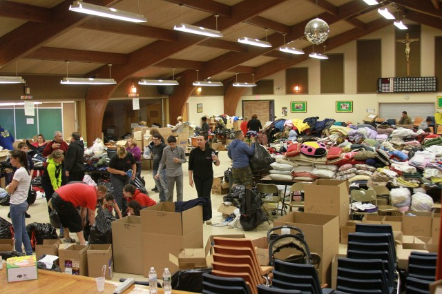 One donation center, St. Justin's Church in Toms River, N.J., converted its facilities into two giant warehouses where dozens of volunteers sorted piles of clothing, food, baby and pet supplies and other household items to help those affected by Hurricane Sandy.