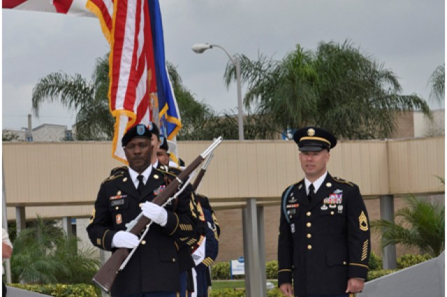 Sgt. 1st Class Michael Christian, right, an instructor at the Defense Equal Opportunity Management Institute, speaks to the Joint Service Color Guard prior to the opening ceremonies for the Massing of the Colors at the Brevard Community College in Cocoa, Fla., Nov. 11, 2012.