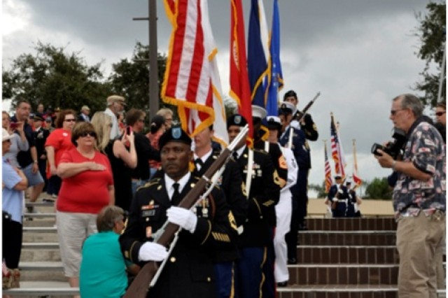 The Joint Service Color Guard, made up of students and faculty from the Defense Equal Opportunity Management Institute, enter the amphitheatre for the Massing of the Colors held at Brevard Community College, Cocoa, Fla., Nov. 11, 2012.
